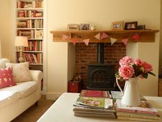 I like the log burner in this room! But we could make use of the storage in the two cupboards either side the fire by making little shelves like on this pic I know the door would cover it but still!