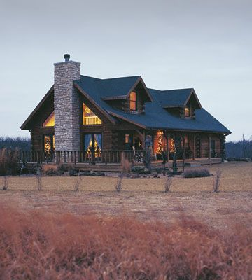 Love the Porch and stone chimney.. And the windows..
