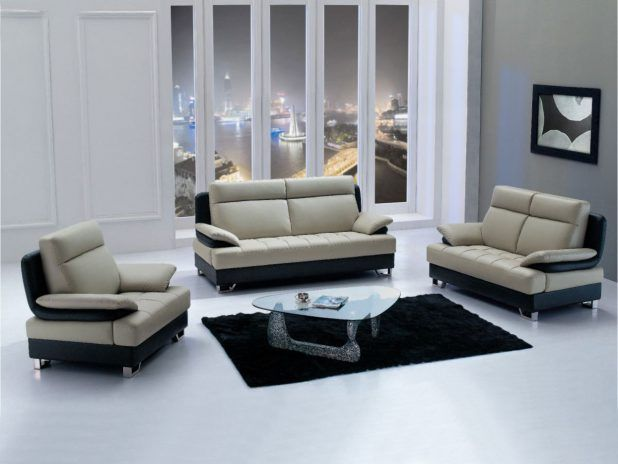 Minimalist suitable living room design idea with black creamy leather covering sectional comfortable couch sofa also black shag rug area and solid glass triangle table top noguchi coffee table and white gray living room wall paint