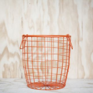 Down to the Woods Wire Basket Medium - Tangerine The uses are endless. Decorative, practical, fill them or even turn them upside down for a stool or a side table. Perfect for a plants, fruit the potoatoes or a waste paper basket! INSTORE + ONLINE NOW