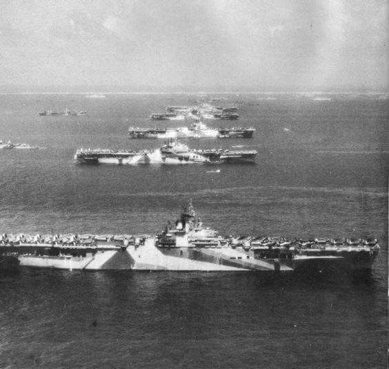 Six Great Carriers In Ulithi Anchorage: Read from foreground to background: USS Wasp, USS Yorktown, USS Hornet, USS Hancock, USS Ticonderoga, and USS Lexington, anchored at Ulithi before a strike on Japan. U. S. Navy Photo.