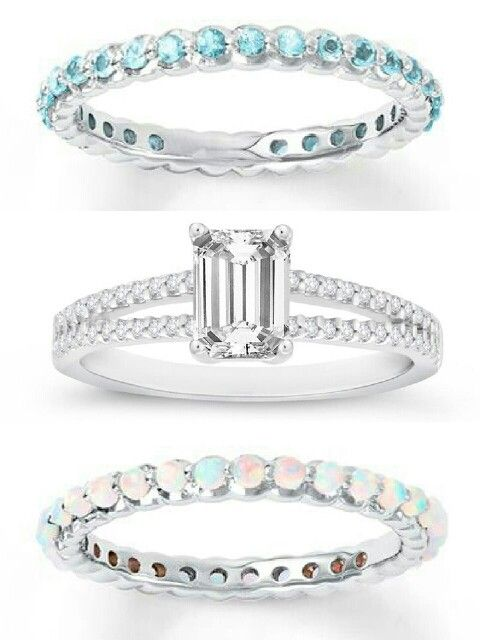 Top - promise ring, his birthstone (blue topaz, December) Middle - engagement ring (diamond, emerald cut) Bottom - wedding ring, her birthstone (opal, October)