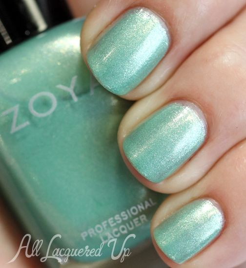 Zoya:  Dillon from Spring 2014 Awaken collection... a spearmint green metallic nail polish with silvery and golden shimmer.
