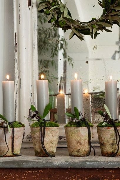 Christmas in Provence...or any type of entertaining.  Candles in small pots with moss.
