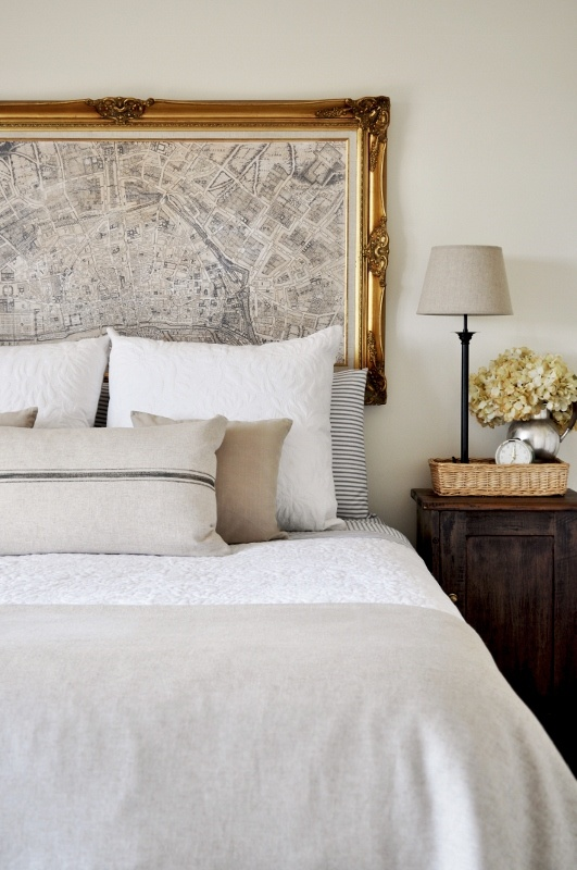 Framed map in gold frame over bed. Nice detail. Perhaps a black frame instead