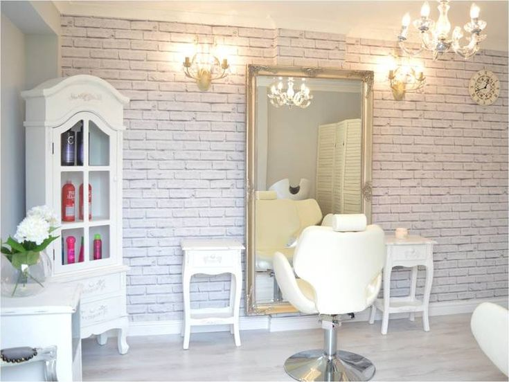 Glamorous, light, luxe Hair Salon. White washed brick walls, elegant chandeliers, grey wooden flooring and shabby chic white French style furniture makes this the perfect place for a relaxing pamper.