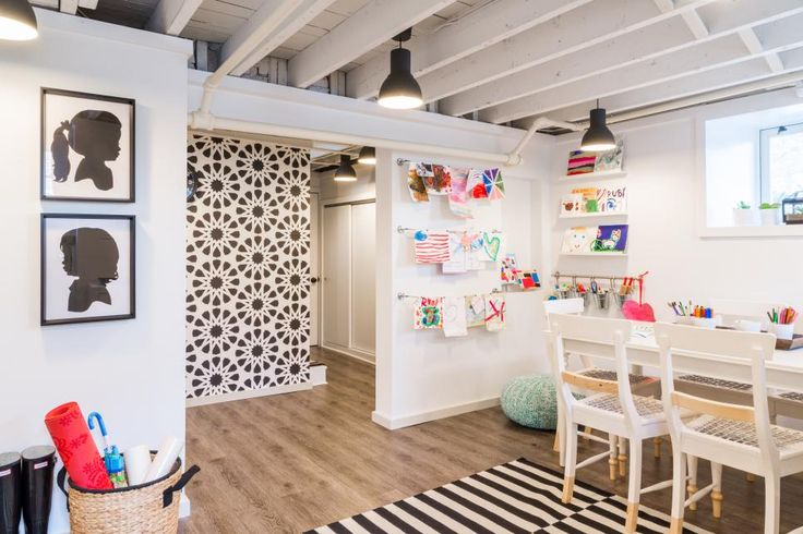 HGTV presents a fun art studio for kids in the low-ceiling basement of a 1920s Colonial. The transitional room features contemporary cabinets and furnishings, and the rafters were exposed and painted white to create a feeling of greater space.