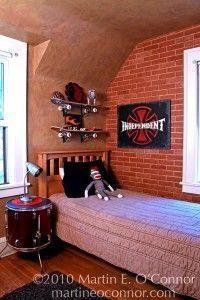 So..need to do this with their old skate boards..Teenage boys room. Love the brick wallpaper.