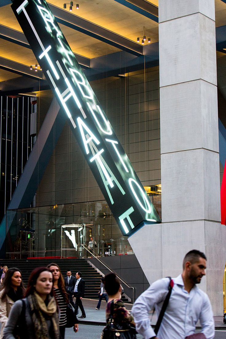 jenny holzer projects poems on 8 chifley square's steel columns in sydney