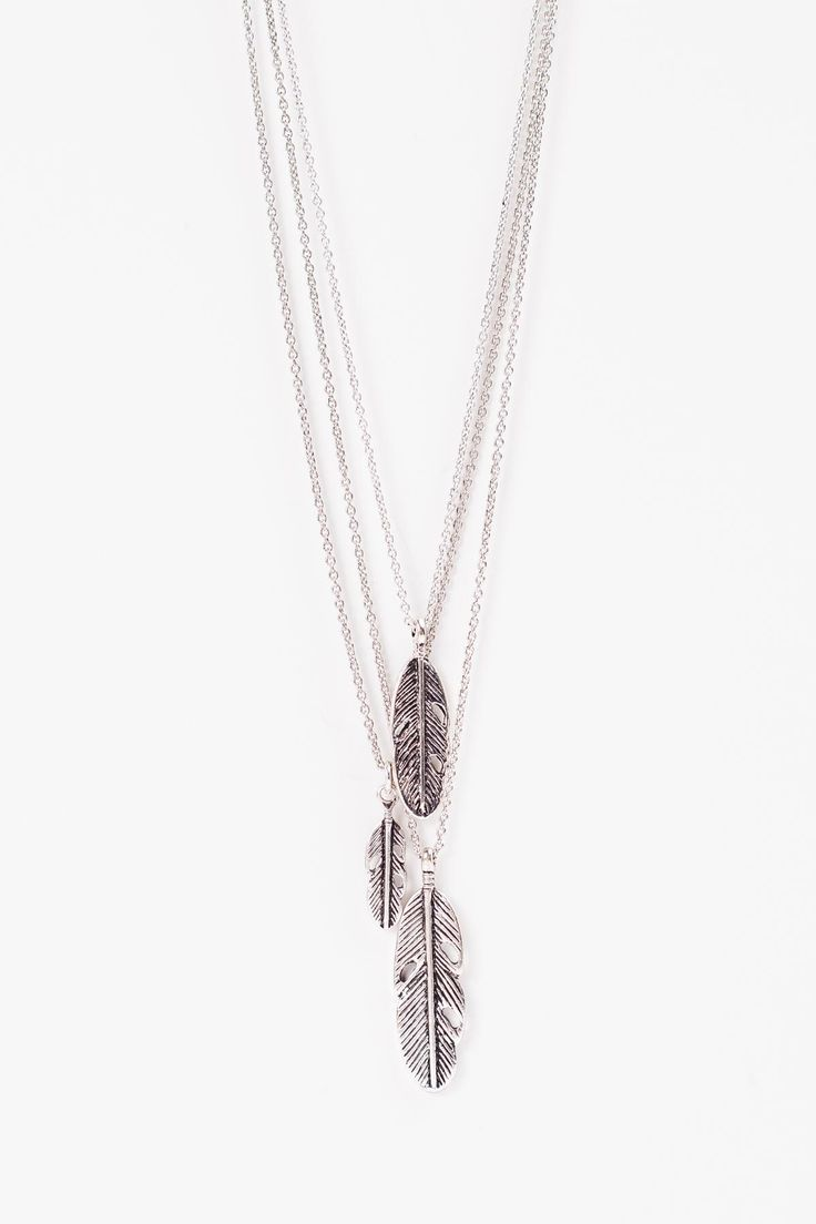 "Drop Feather Necklace  Three layered silver feathers in varying sizes fall perfectly.   Length: 17"" Extension: 3"""