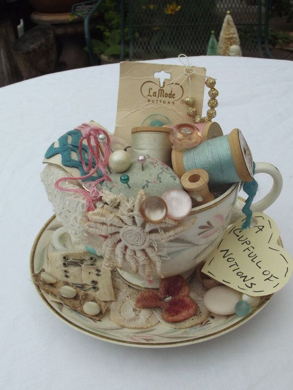 $22.00 USD Vintage tea cup filled with goodies and notions.