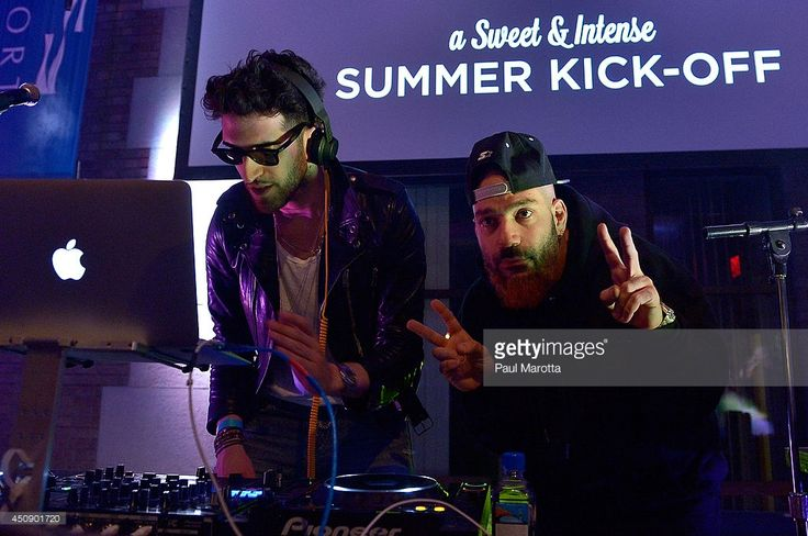 """David Macklovitch (L) and Patrick Gemayel of Chromeo perform onstage during Johnny Appleseed Hard Apple Cider's celebration to kick off the summer season at the Seaport World Trade Center in Boston with the World's Largest Ice Luge. Attendees enjoyed samples of Johnny Appleseed Hard Apple Cider from the Ice Luge, which at 25 feet tall surpassed the current record holder by two feet and weighed in at an impressive 25,000 lbs. Chromeo's hit song """"Jealous"""" is featured in Johnny Appleseed's…"""