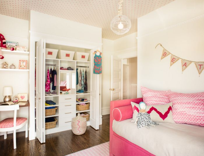 Charming girls room with pink daybed, organized closet, polkadotted
