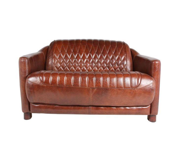 Великолепный диван в кожаной обивке с рельефным сидением и спинкой.             Метки: Маленькие диваны.              Материал: Кожа натуральная.              Бренд: American Interiors.              Стили: Лофт.              Цвета: Коричневый.