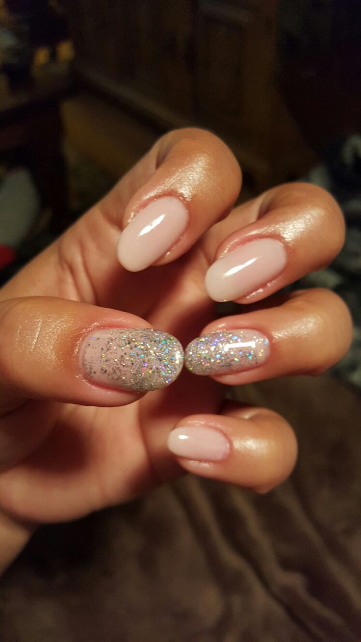 Sculpted gel nails with nude & holographic gel polish