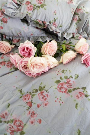 Shabby Chic Couture floral sheets; I used to have this spread and shams. Painted my bedroom walls to match one of the shades of pink.