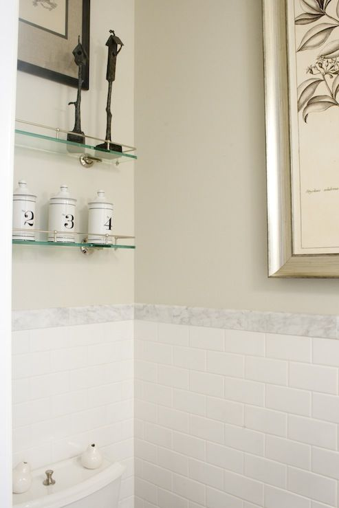 white subway tile with strip of marble tiles. want to do this in the kitchen but with white tiles above as well.