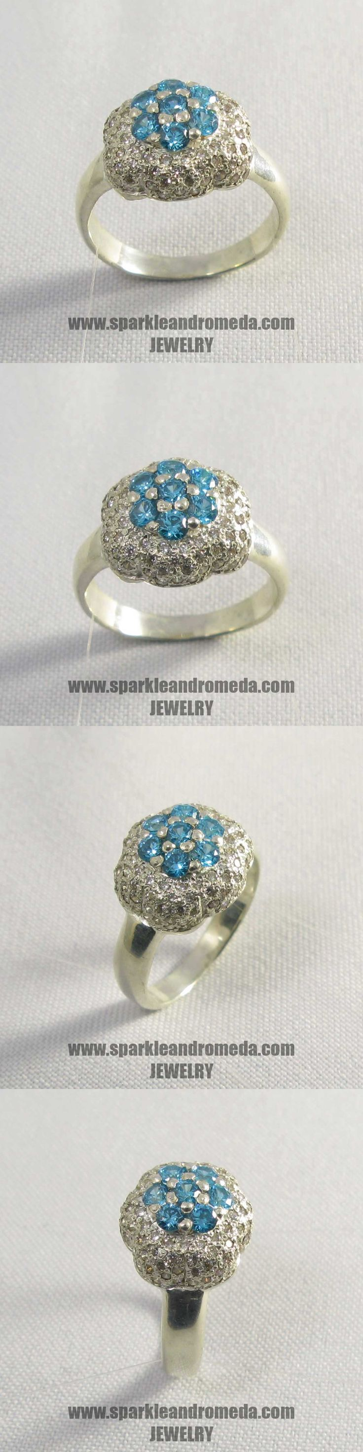Sterling 925 silver ring with 7 round 2,5 mm blue color and 92 round 1,25 mm white color cubic zirconia gemstones.