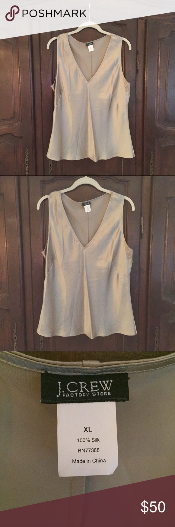 """J Crew v neck sleeveless silk top XL J Crew v neck sleeveless silk top XL. Bust 23"""" length 25"""". Beautifully tailored, bias cut for flattering fit. Purchased from outlet, tags removed but never worn. J. Crew Tops Camisoles"""