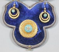 Lot No 719 A mid Victorian gilt metal suite of jewellery comprising a turquoise set etruscan style brooch and a pair of double hoop drop turquoise earrings, sold for £280