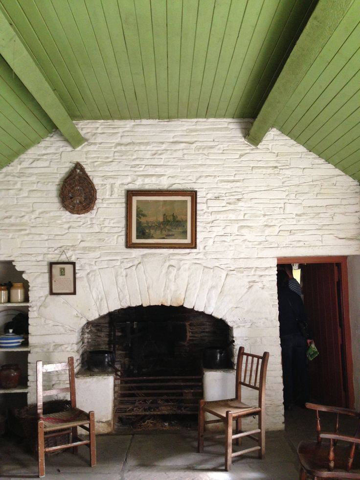 white washed stone walls and green painted timber clad ceiling interior irish cottage - Stone Cottage Interiors
