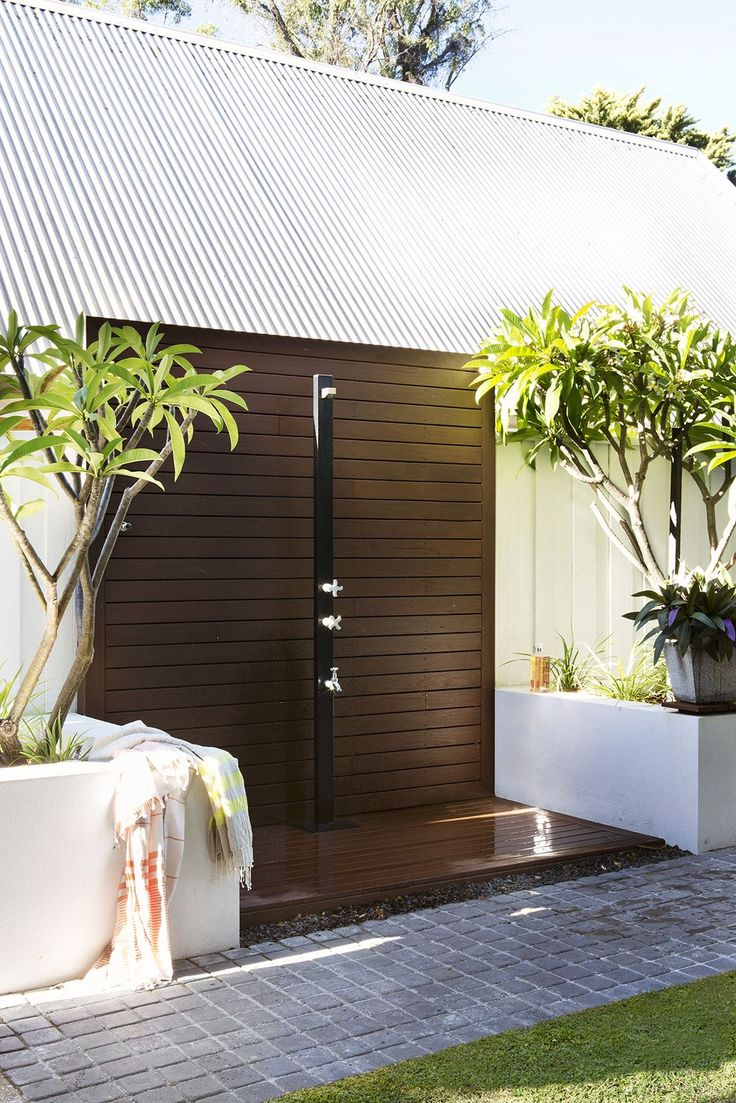 "Frangipani trees frame an outdoor shower in the courtyard. The timber used throughout is hardy native jarrah from [AusWest Timbers](http://auswesttimbers.com.au/?utm_campaign=supplier/|target=""_blank"").  Aussie Premium 2503 freestanding **outdoor shower** from [Rainware](http://www.rainware.com.au/?utm_campaign=supplier/