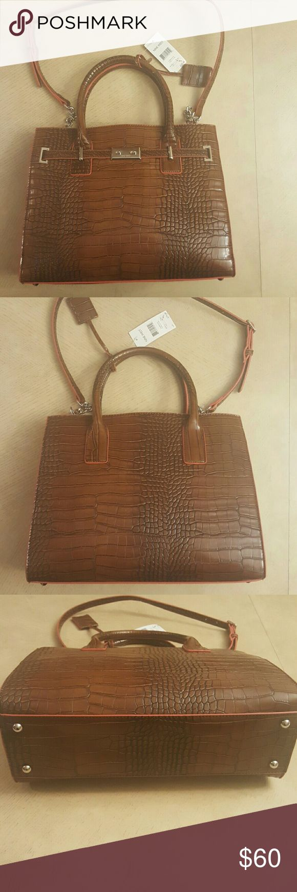 NWT Nine West Internal Affairs Large Tote Tobacco NWT Nine West Internal Affairs Large Tote Tobacco. Excellent condition with original tags. Nine West Bags Totes