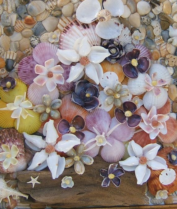 Beach Decor Seashell Flower Picture-If you like seashell flowers, you will love this picture! It has a background of seashell pieces all carefully placed and glued on a canvas board. On top of that background is a beautiful flower arrangement with a driftwood base. Flowers are made of genuine seashells all naturally colored.