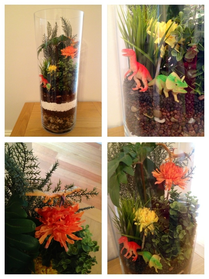 DIY Dinosaur Terrarium. Supplies from Ikea - vase, rocks, plants and flowers. Dinosaurs from a very large collection belonging to my 5 year old.