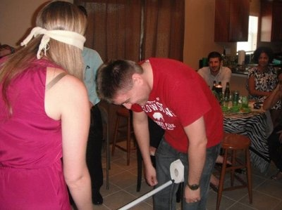 Now this looks really fun for a co ed shower its called get er groom she uses a broom stick to get the toilet paper from his legs lol blinded folded everyone participates and draw their opposite sex partner from a hat which ever team completes the task the quickest wins the game prize
