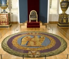 This medallion made up the center of the great carpet in the throne room at the Palais des Tuileries. Delivered in 1810 for the marriage ceremony of Napoleon I and Marie-Louise, it is decorated with the symbols of the Empire. The decoration fell into disfavor under the Restoration, and the carpet was cut up. The medallion in the Louvre gives some clue to what the original carpet must have looked like.