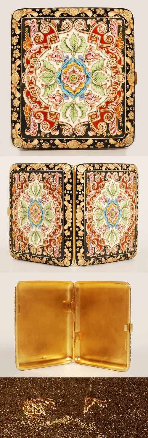 A Russian silver gilt and cloisonne enamel cigarette case, Feodor RUckert, Moscow, 1896-1908. Both sides lavishly decorated in multi-color shaded enamel scroll, floral and geometric motifs within a border of stylized amber colored floral designs against a black enamel ground.