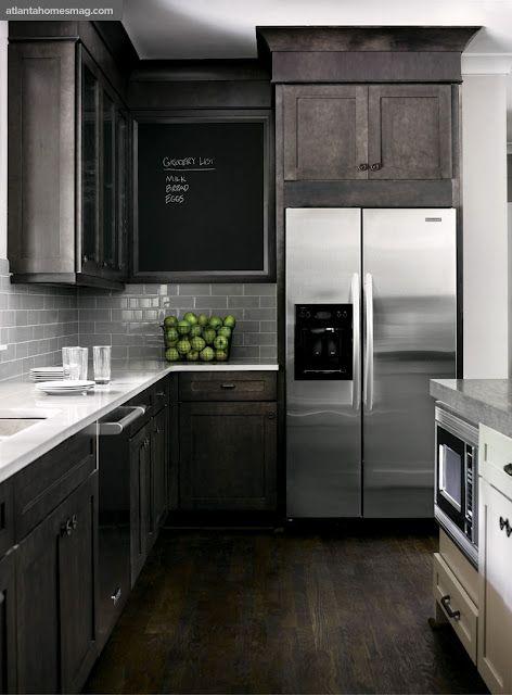 gray cabinets, gray backsplash, white countertops, & dark floors