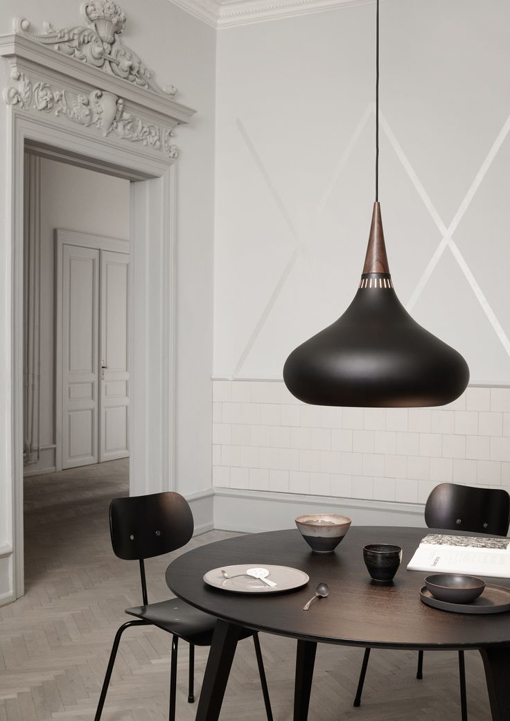 Dining room featuring the Orient Black pendant by Jo Hammerborg.