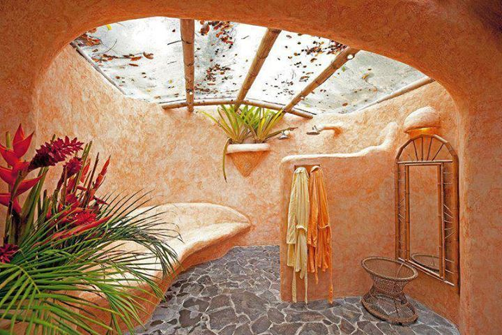 cob house bathroom steel beams made to look like wood strong enough to hold logs and/or stones if need arises