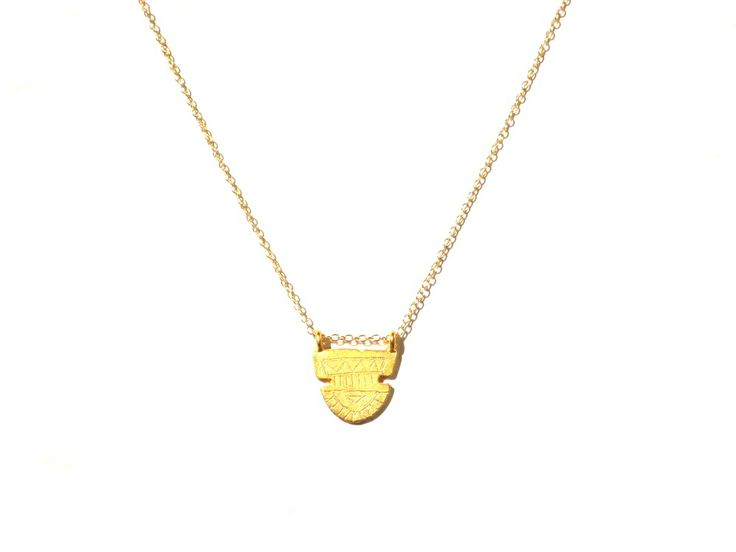 This beautiful gold plated necklace features an engraved semi circle Aztec design. It is a solid charm with a flat back matte gold plated finish. Strung on a 14k gold filled chain with 14k gold findings. This necklace will not discolour easily but with all Gold plated jewellery I suggest you keep it away from water and perfumes to protect its longevity. Chain length is 18 inches (45..5 cm)Can make a custom length chain.Charm dimensions-23mm x 21mm.Also av...