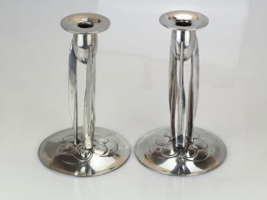 Tudric pewter candlesticks designed by Archibald Knox  and retailed by Liberty & Co. C 1902-1905   In excellent condition. 23.5cm tall  Marked to base MADE  IN ENGLAND  ENGLISH PEWTER 0223  4