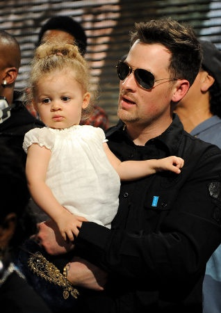 Harlow Madden with her singer dad, Joel Madden