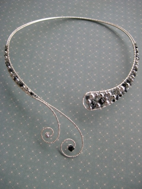 Love these wire collars!  Usually the embellishment is at the ends, but this is an awesome pearl design.