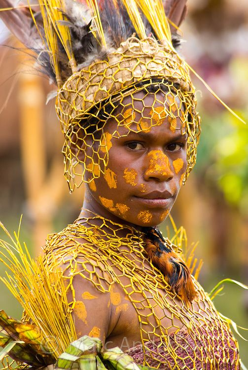 Portrait of a young woman from the Okapa tribe. She is dressed in traditional tribal dress for the Goroka Show, an annual Singsing Festival in the highlands of Papua New Guinea by Marc Anderson Photography #world_cultures