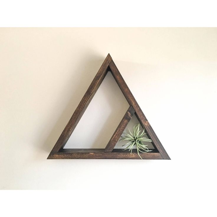 2 Tier Wooden Triangle Shelf (Large triangle in photos)    These geometric shelfs can serve as unique crystal/jewelry displays or shadow boxes.    Measurements: height 17in x base width 19in x depth 3.5in