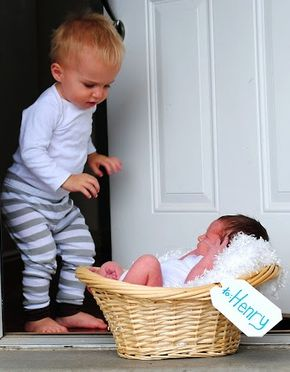 A creative picture of a newborn and sibling. Special delivery...