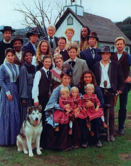 Townfolks in Dr. Quinn Medicine Woman. Back row:  Rev. Tim Johnson, Jake Slicker, Loren Bray, Dorothy Jennings and Cloud Dancing. Third row: Robert E., Hank Lawson, Preston Lodge, Horace Bing and Daniel Simon. Second row:  Teresa Morales, Grace, Brian Cooper, Colleen Cooper Cook, Andrew Cook and Matthew Cooper. Front row:  Dr. Michaela Quinn Sully and Byron Sully holding the girls that play Katie Sully (Megan, MacKenzie and Alexandria Calabrese).