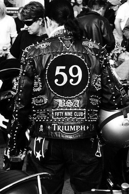 Ace Café by Simon Crubellier, wearing a studded leather jacket and note the long hair because know the national serves had stopped they rebelled against the short hair cut.