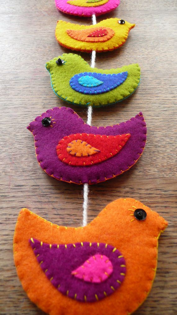 one more felt bird garland--I like the color combos and the sequin+bead for the eye