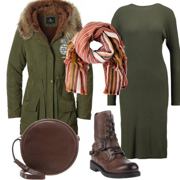 Verde e cuoio sono i colori di questo abbigliamento. Il vestito in viscosa, con uno spacco laterale e una scollatura a V, è abbinato ad una sciarpa a righe colorate. Gli stivaletti con i lacci e la borsina tonda sono in pelle. Sopra a tutto il caldissimo parka imbottito. Adatto per il tempo libero ma anche per lufficio.