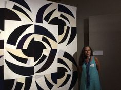 Today I thought I'd share a few pictures of quilts and artists. First is Valerie Maser-Flanagan with her two quilts, Growth Rings #1 and #...