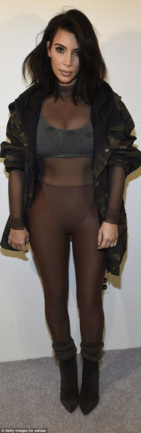 His biggest fan: Kanye's wife Kim Kardashian showed up to the event wearing a brown body stocking with a grey crop top and a camo jacket