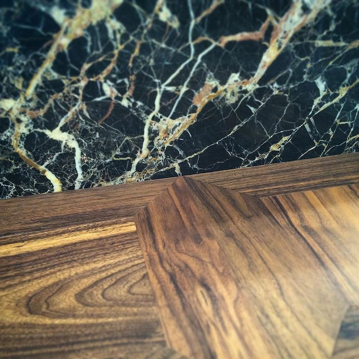 St. Laurent marble and square walnut parquet