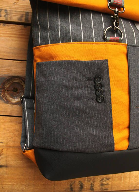 The sleeve from a men's suit as a front pocket of your backpack!